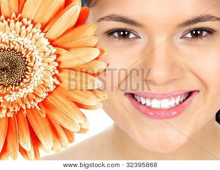 Beautiful young woman smile with flower. Dental health.