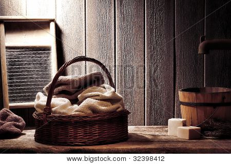 Dry Towels In Old Wicker Basket In Vintage Laundry