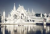 CHIANG RAI, THAILAND - FEBRUARY 2019: wat Rong Khun The famous White Temple in Chiang Rai, Thailand poster