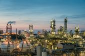 Oil And Gas Refinery Plant Or Petrochemical Industry On Sky Sunset Background, Gas Storage Sphere Ta poster