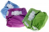 stock photo of diaper change  - Eco Friendly Cloth Diapers in Green Purple and Blue Isolated on White - JPG