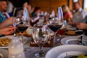 Wine Goblets On Restaurant Table. Served Restaurant Table. poster