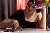 stock photo of table manners  - attractive sad girl sitting at the table - JPG