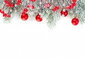 Christmas Concept. Xmas Border Composition With Red Glass Baubles, Holly Berries And Green Fir Branc poster