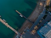 Aerial View Of The Seashore - Turquoise Water, Piers And Boats At The Pier poster
