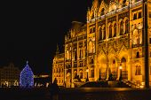 Christmas Tree In Front Off Parliament Building, At Kossuth Square, Budapest, Hungary poster