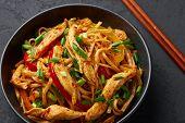 Chicken Schezwan Noodles Or Hakka Or Chow Mein In Black Bowl At Dark Background. Schezwan Noodles Is poster