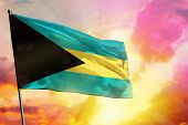 Fluttering Bahamas Flag On Beautiful Colorful Sunset Or Sunrise Background. Bahamas Success And Happ poster