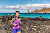 Galapagos tourist walking on Santiago Island in Galapagos Islands. Pinnacle Rock and Bartolome Islan poster
