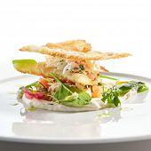 Crab napoleon with pike caviar sauce closeup. Natural seafood restaurant menu item. Delicious snack, poster