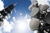 picture of mast  - low angle view of two telecommunications towers against the sky