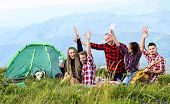 Men And Women On Picnic At Tent. Wanderlust Discovery. Mountain Tourism Camp. Group Of People Spend  poster