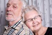 pic of elderly couple  - portrait of an elderly couple loving each other - JPG