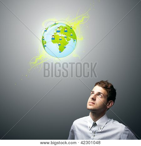 Young businessman holding virtual eco sign