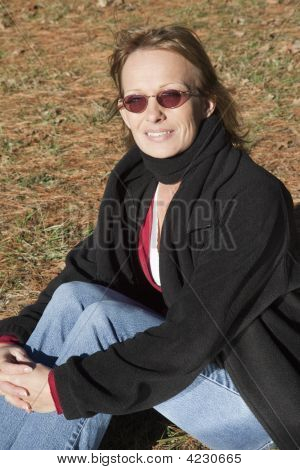 Portrait Sitting On Grass