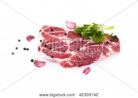 Raw Steaks Of Pork Neck Over White