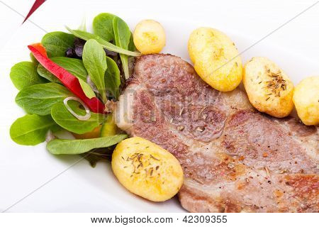 Closeup Of Grilled Steak With New Potatoes