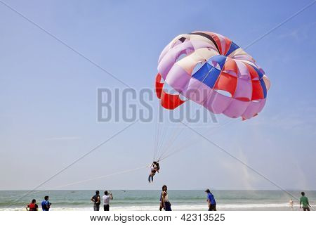 Sand Flies As Paraglider Takes Off