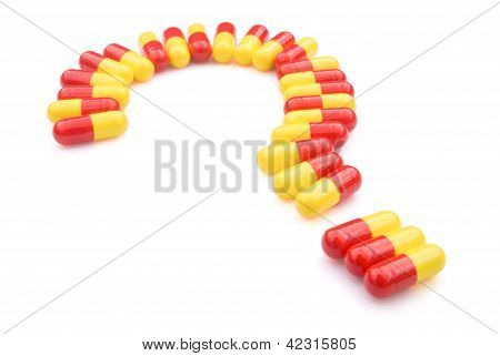 Capsules Line Up As A Question Mark
