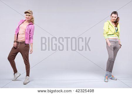 Two cheerful girls posing