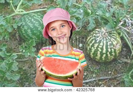Adorable girl eating watermelon in a plantation