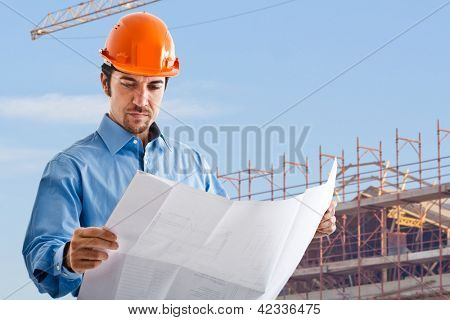 Handsome architect reading a drawing