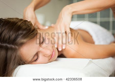 Young woman getting a massage in a spa