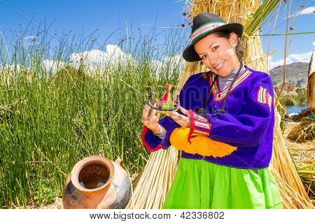Woman, in indian costume on Uros island Peru