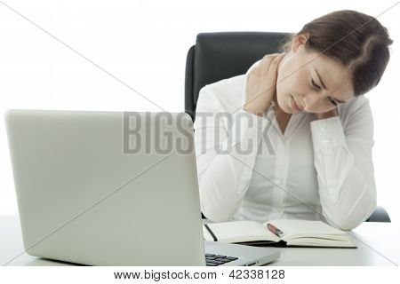 Young Brunette Business Woman Has Pain Neck Behind Computer