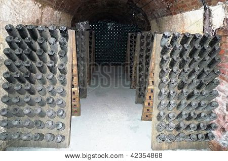 Champagne Bottles Stored In A Cellar During Riddling