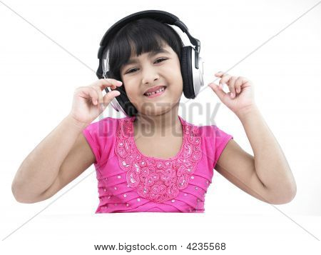 Asian Girl Of Indian Origin Listening To Music