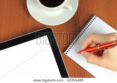 Touch screen device notepad writing hand and cup of coffee