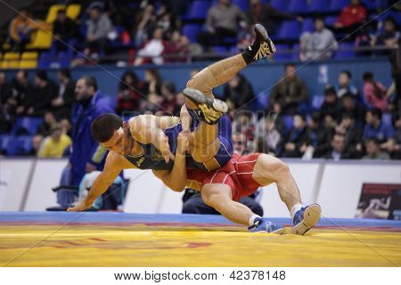 KIEV, UKRAINE - FEBRUARY 16: Match between Chakayev, Russia, red and Mashadov, Russia during XIX International freestyle wrestling and female wrestling tournament in Kiev, Ukraine on February 16, 2013