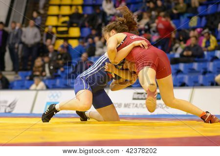 KIEV, UKRAINE - FEBRUARY 16: Match between Omelchenko, Ukraine, red and Martinakova, Czech Republic during XIX International female wrestling tournament in Kiev, Ukraine on February 16, 2013