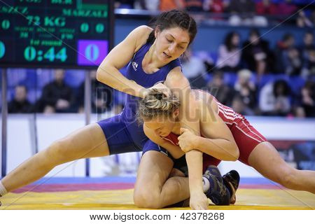 KIEV, UKRAINE - FEBRUARY 16: Match between V. Marzaliuk, Belarus, blue and A. Wieszczek-Kordus, Poland during XIX International female wrestling tournament in Kiev, Ukraine on February 16, 2013