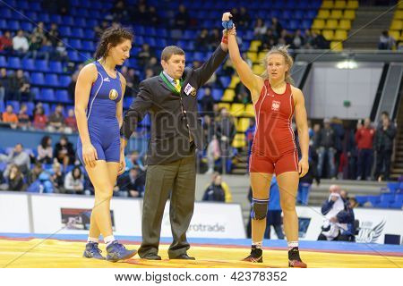 KIEV, UKRAINE - FEBRUARY 16: A. Wieszczek-Kordus, Poland win the match with V. Marzaliuk, Belarus during XIX International female wrestling tournament in Kiev, Ukraine on February 16, 2013