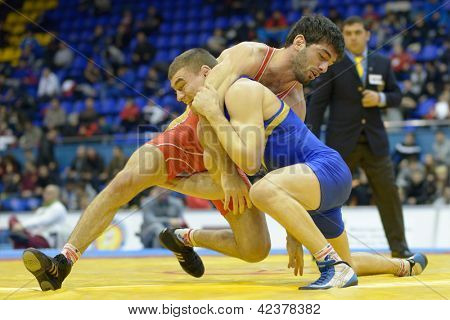 KIEV, UKRAINE - FEBRUARY 16: Match between Tsabolov, Russia, red and Radulov, Ukraine during XIX International freestyle wrestling and female wrestling tournament in Kiev, Ukraine on February 16, 2013
