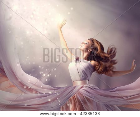 Fashion Art Beauty Portrait. Beautiful Girl, Model Woman wearing Long Chiffon dress. Magic. Miracle. Fantasy Scene