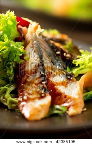 Salad With Smoked Eel and Unagi Sauce. Japanese Food