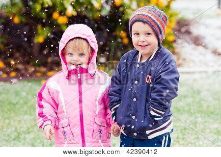 Children bundled for snow