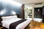 picture of comforter  - Interior of modern comfortable hotel room - JPG