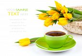 stock photo of easter_break  - coffee cup with yellow tulips on white background - JPG
