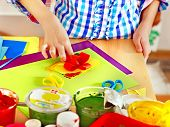 foto of card-making  - Child making decoration card with bow - JPG