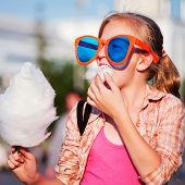 pic of candy cotton  - Girl eating cotton candy - JPG