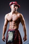 stock photo of kilt  - Scottish traditions concept with person wearing kilt - JPG