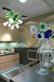 picture of dutch oven  - glass vase with graceful flowers in interior of the kitchens with oranges and beautiful chandelier - JPG