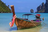 stock photo of phi phi  - Long tailed boat Ruea Hang Yao on the beach at Holidays sunny tranquil paradise beach on Phi Phi island - JPG