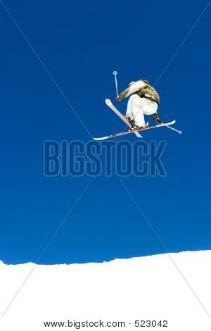 Man Skiing On Slopes Of Prodollano Ski Resort In Spain