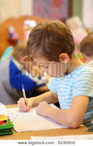 Drawing Boy In Kindergarten