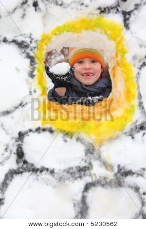 Boy With  Snowball In Snow Fortress